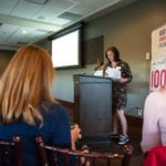 Christy Parker speaking at 100 WWC meeting