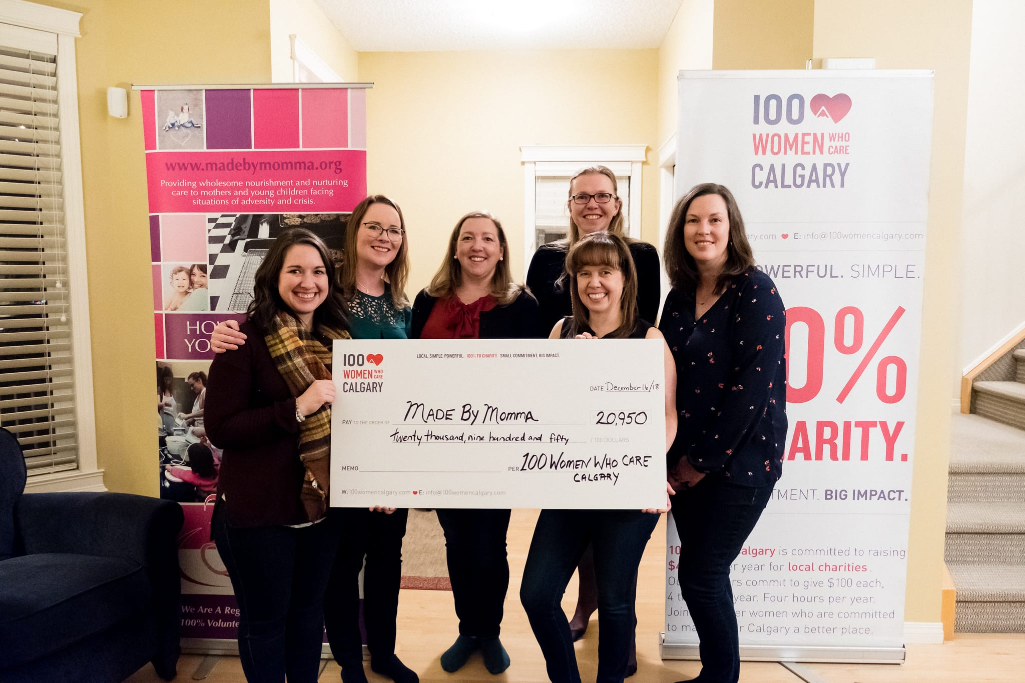 Cheque presented to Made by Momma by 100 Women Who Care Calgary